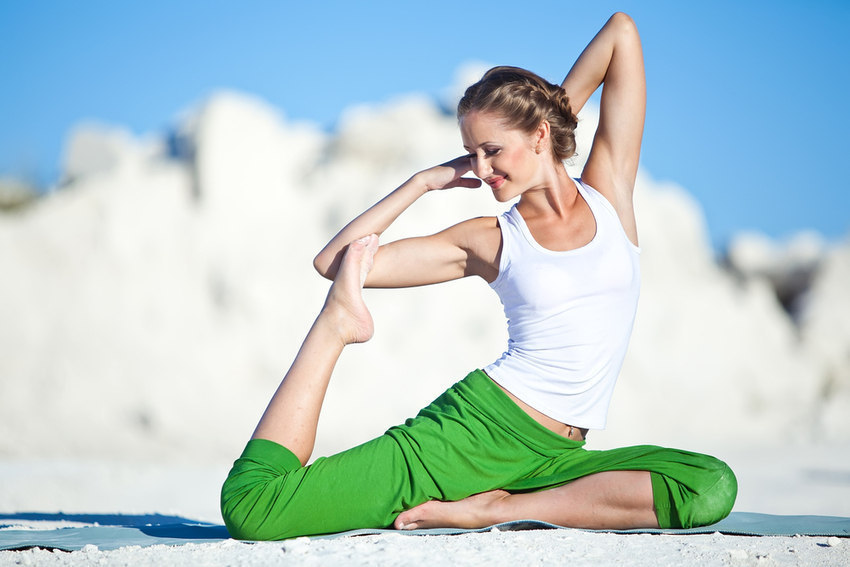 Yoga full pigeon woman happy smile 850x567